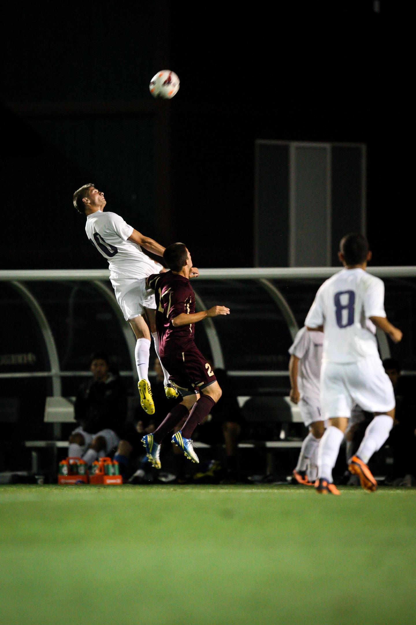 University of Washington Huskies Men's Soccer Forward Kyle Coffee Header against Seattle Pacific University