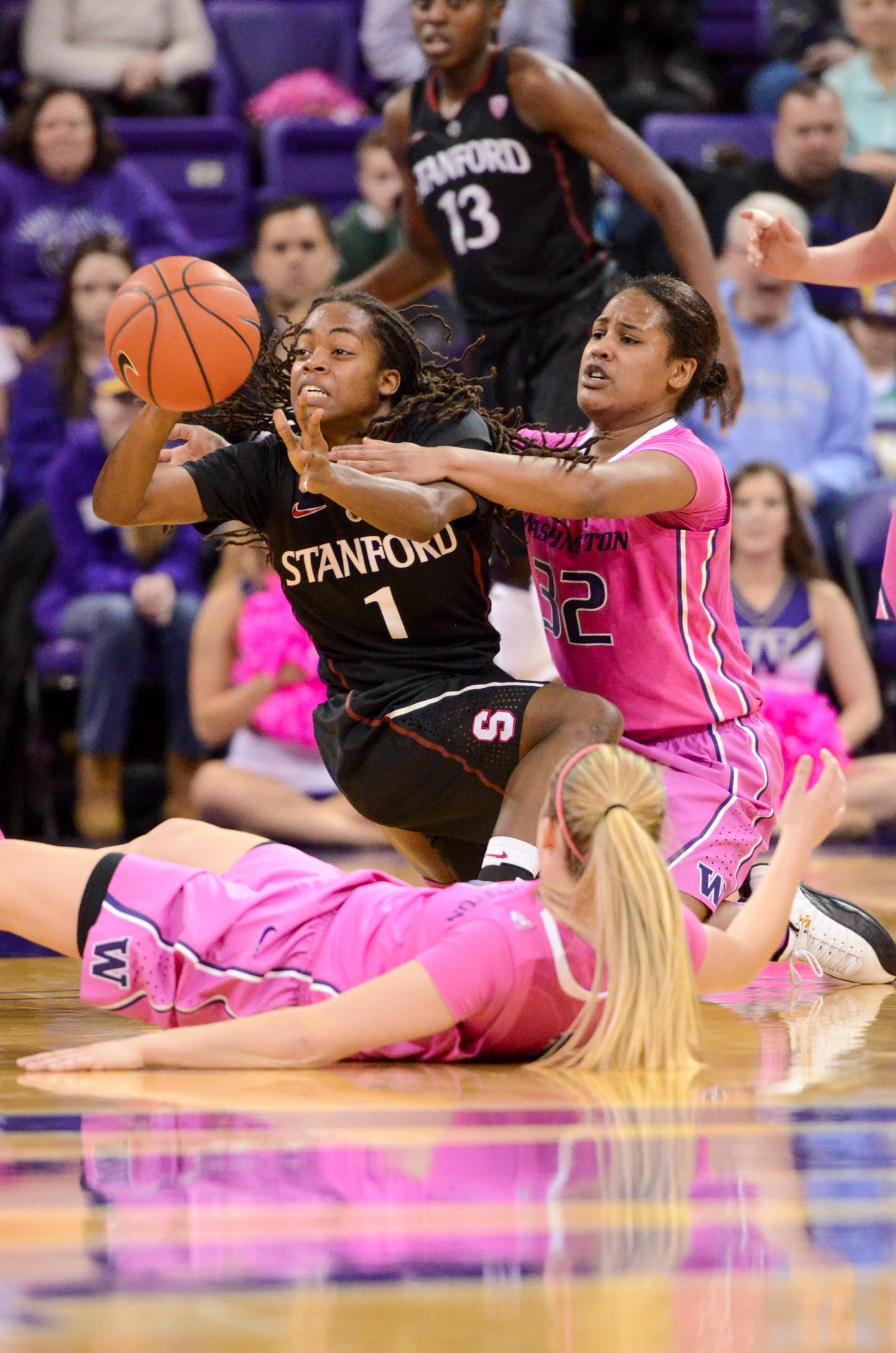 University of Washington Huskies Women's Basketball Point Guard Jazmine Davis Fighting for Ball