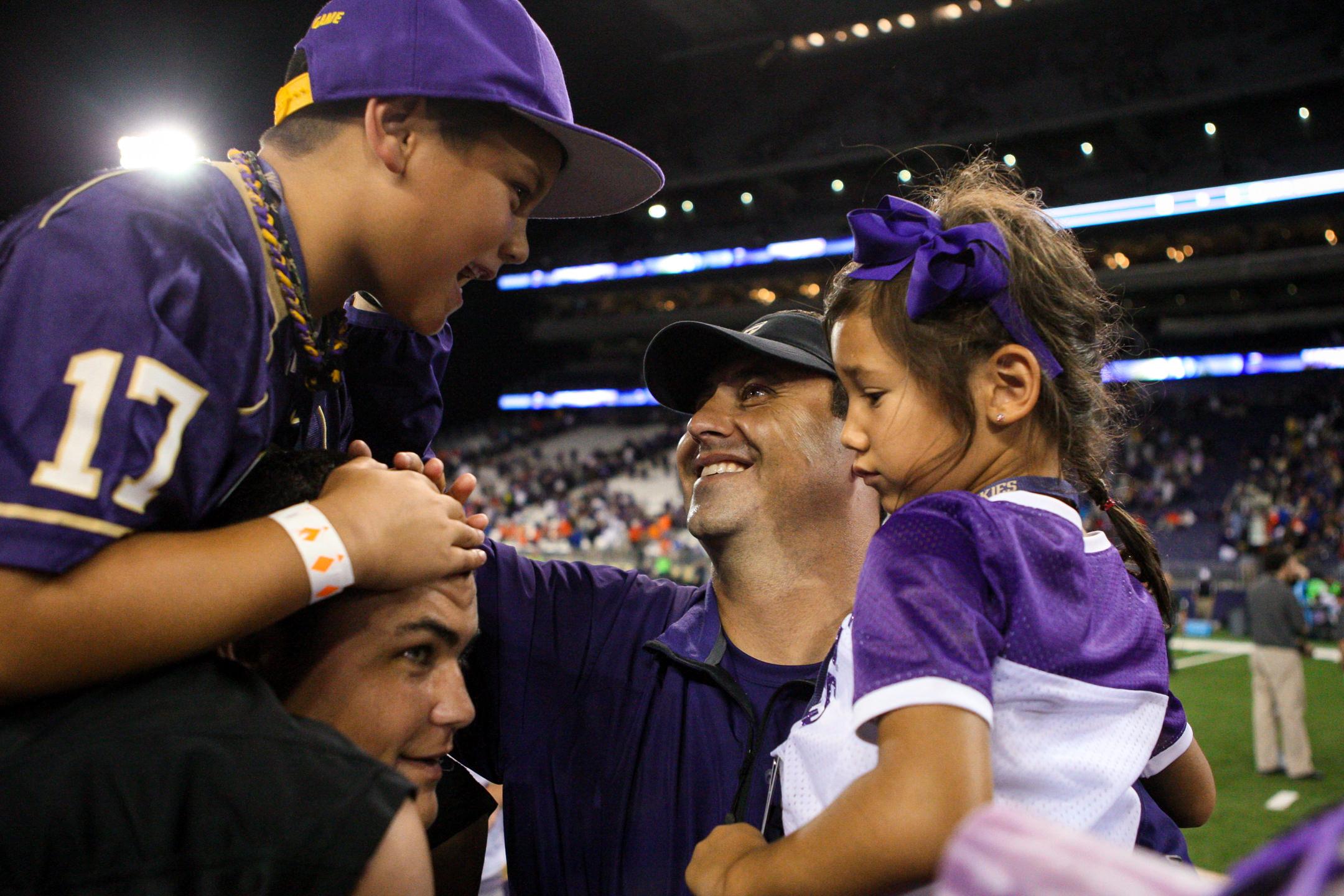University of Washington Huskies Football Head Coach Steve Sarkisian Celebrates with Kids