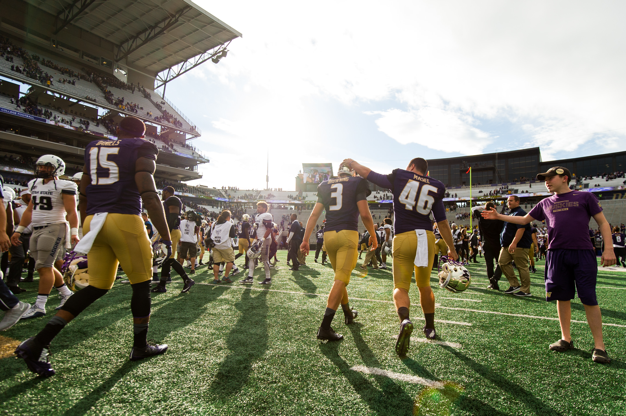 University of Washington Huskies Football Quarterback Jake Browning and Long Snapper Ryan Masel Walk Off Field