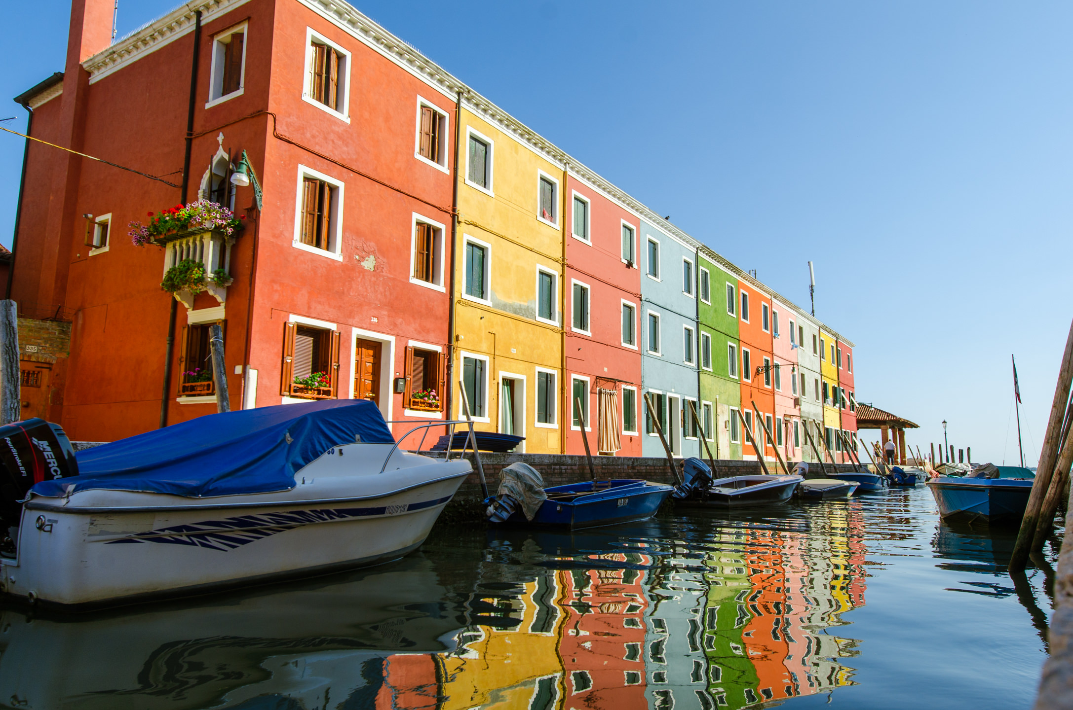 Colorful Homes and Boasts along the Canals in Burano Italy outside of Venice