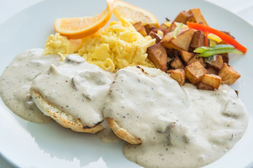 Biscuits and gravy with scrambled eggs and breakfast potatoes