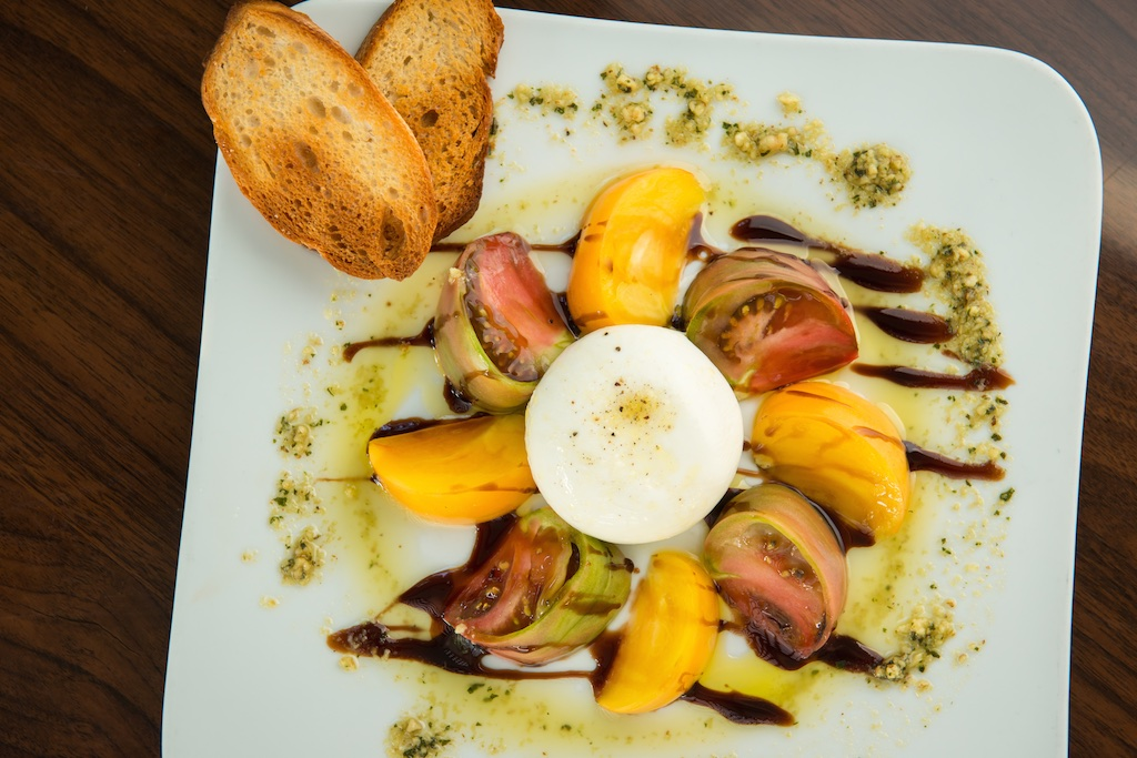 Bagatelle lunch and dinner, burrata and heirloom tomato salad