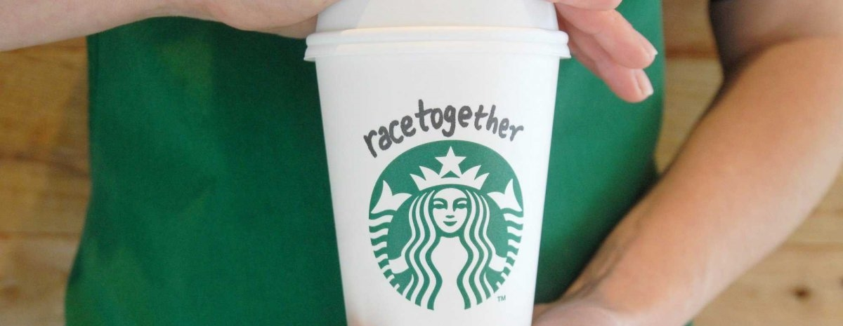 """Baristas at 12,000 Starbucks locations will be encouraged to start conversations about race relations by scribbling """"Race Together"""" on customers' cups."""
