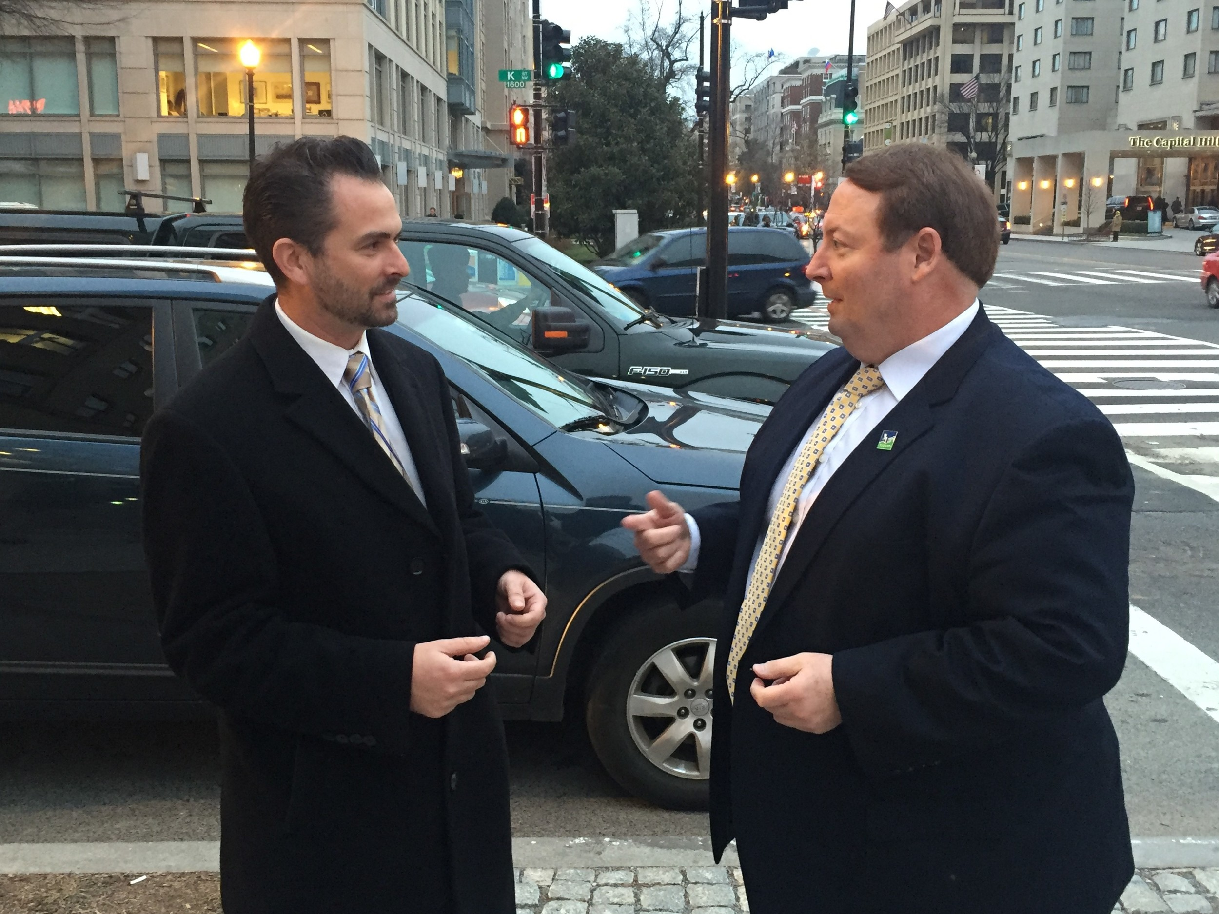 Joel Rubin, left, with Tigard Mayor John Cook, right, discusses federal items highlighted at a recent Conference of Mayors event in Washington, D.C. Rubin, who leads CFM's federal affairs team, just became the firm's newest partner.