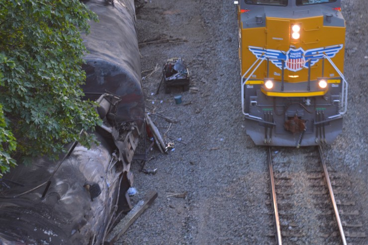 """A Union Pacific spokesman apologized for the """"inconvenience"""" of an oil train derailment in Mosier that closed a school, shut down a sewer system, drained the water supply and leaked into the Columbia River."""