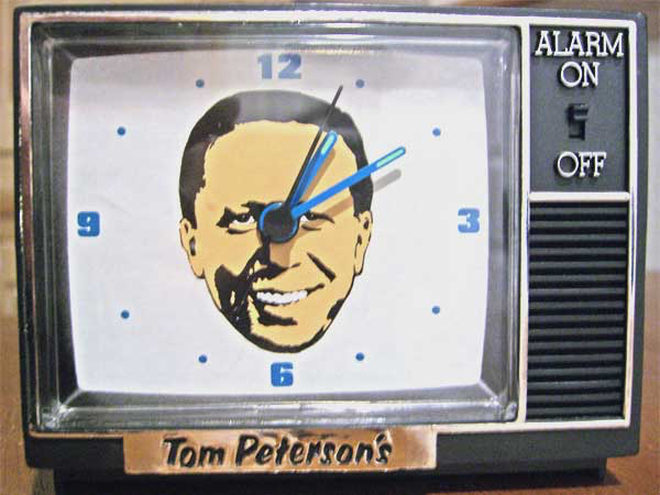 "Tom Peterson's trademark flat-top image was everywhere in Portland – on alarm clocks, wristwatches and coffee mugs. And Tom Peterson was a constant presence on TV, inviting people to come to his ""happy place to buy."""