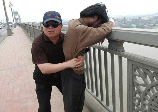 A Chinese man dedicates his weekends to saving people about to commit suicide. He serves as a reminder there are men, women and children around us doing equally powerful things to change their and our world.