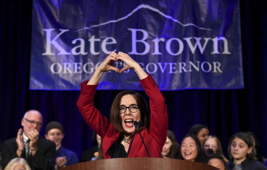 Oregon Governor Kate Brown overcame a trail of administrative miscues and an aggressive campaign by challenger Knute Buehler to win re-election to a full four-year term. High voter turnout also swept out three Republican House incumbents and gave Democrats supermajorities in both the House and Senate. [Photo Credit: Steve Dykes, AP]