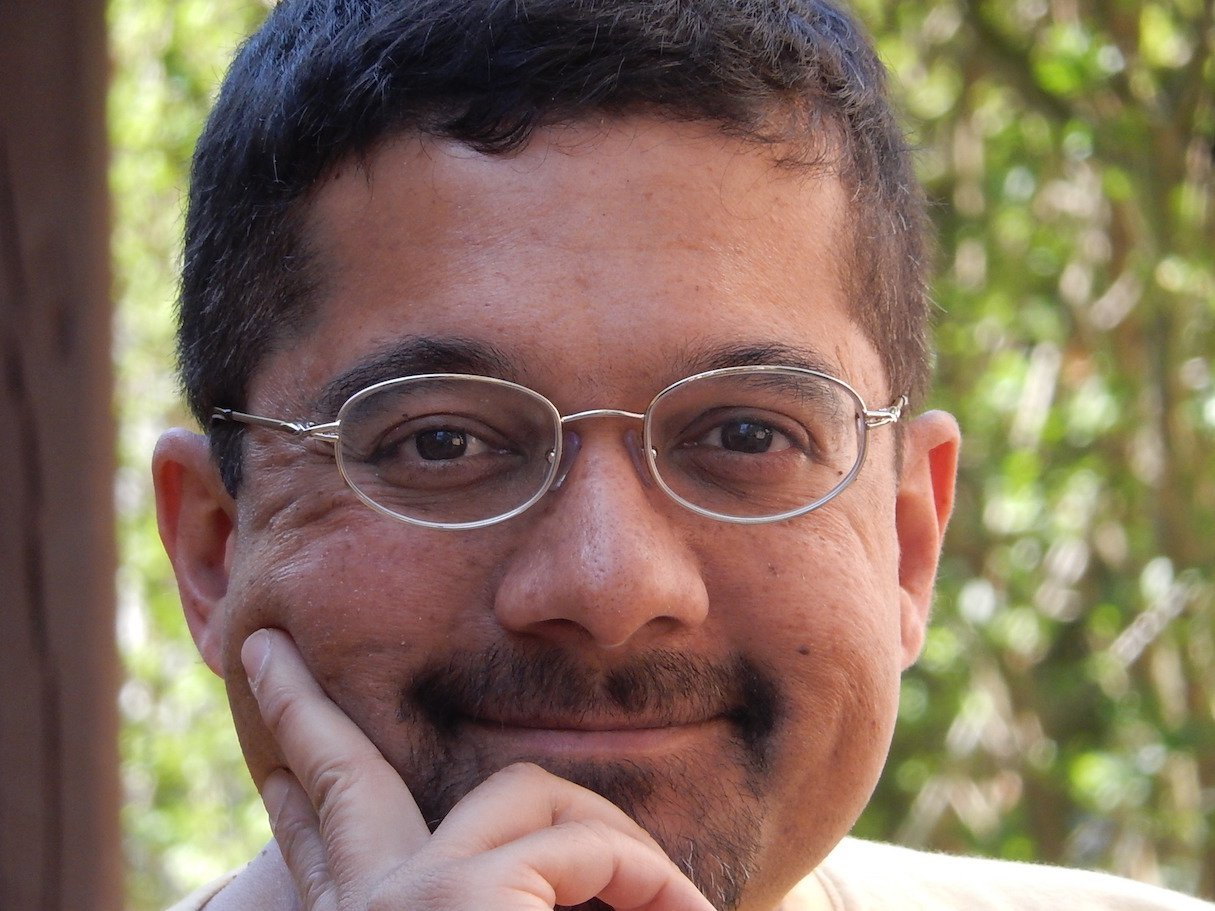 Shankar Vedantam does what public opinion pollsters can't do – look inside the hidden brains of people to learn why they behave as they do. [Photo Credit: NPR]