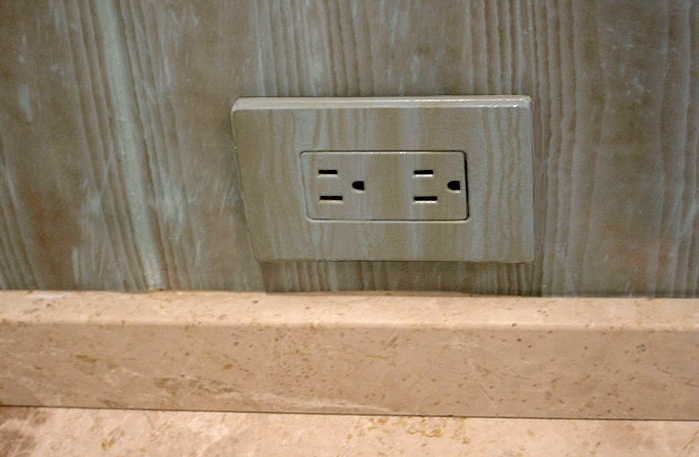 Faux wood outlet to blend existing wood on baseboard