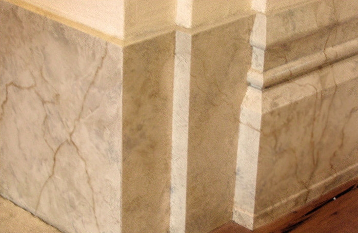 Faux marble on baseboard.