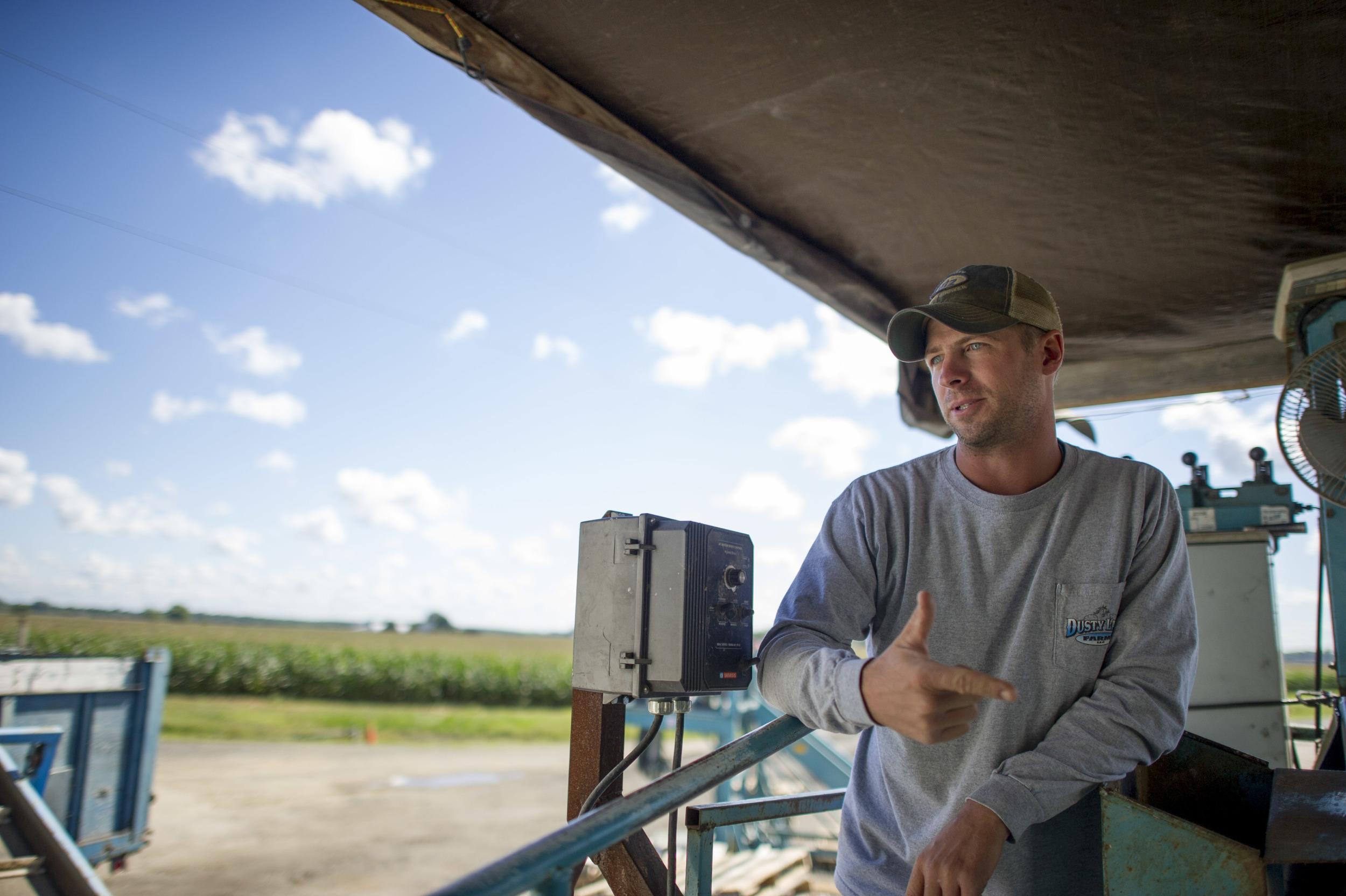 Michael overlooking the potato harvester.