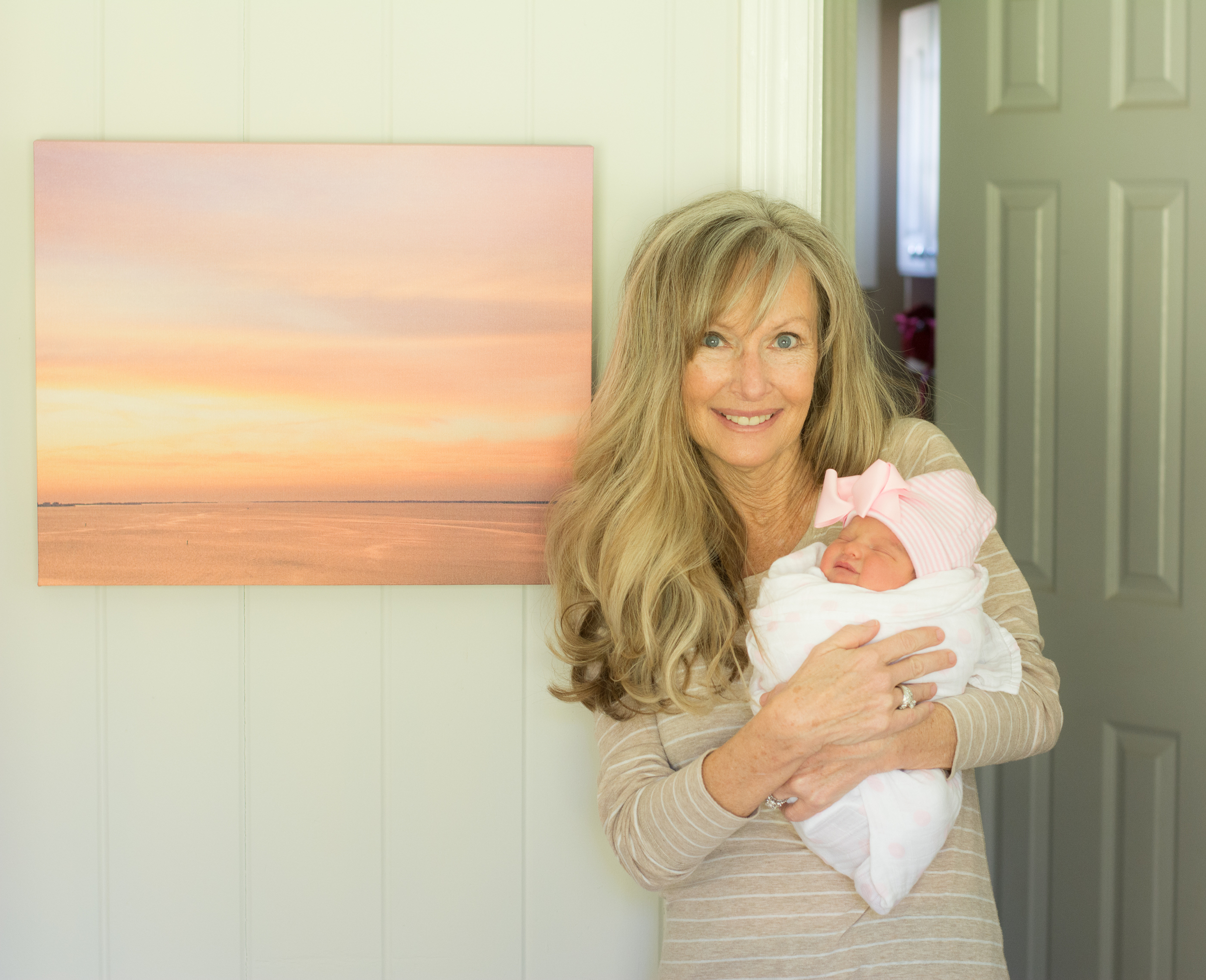 My own grand-bundle next to a pink sunset I captured for her room. She is destined to love the beach!