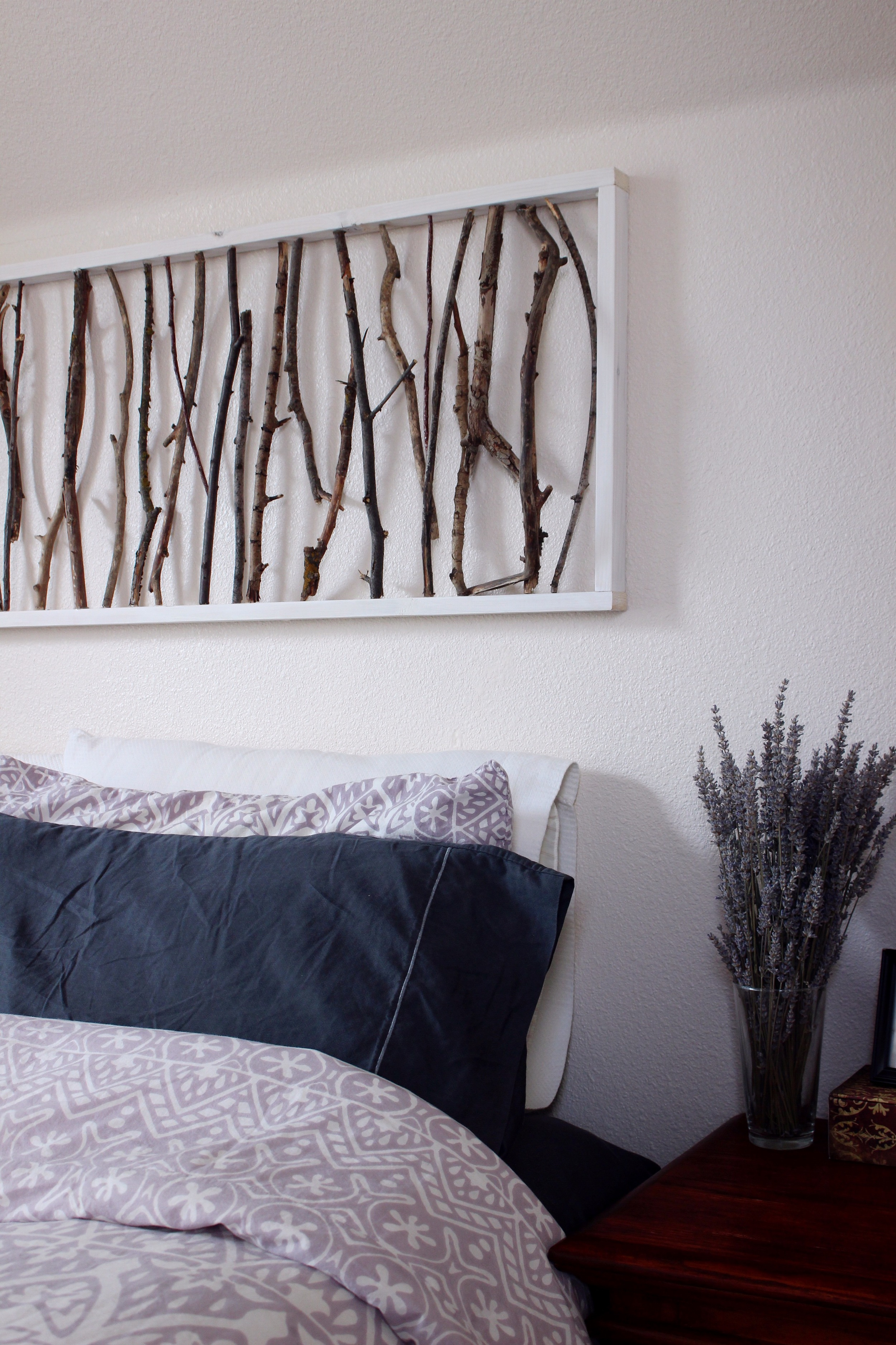 branch art above the bed