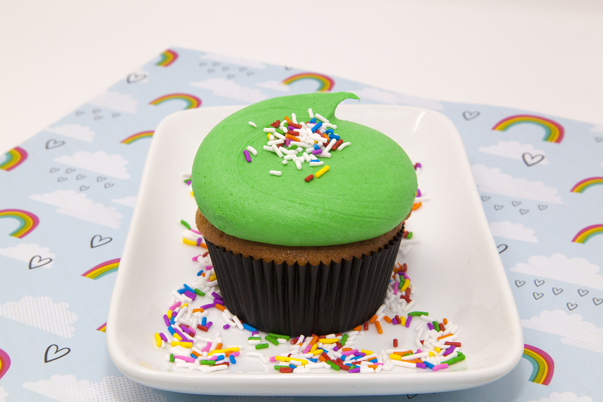 Shamrock Vanilla  - Basically a Vanilla Cupcake with green shamrock green frosting and rainbow sprinkles - Simple, cute and festive!