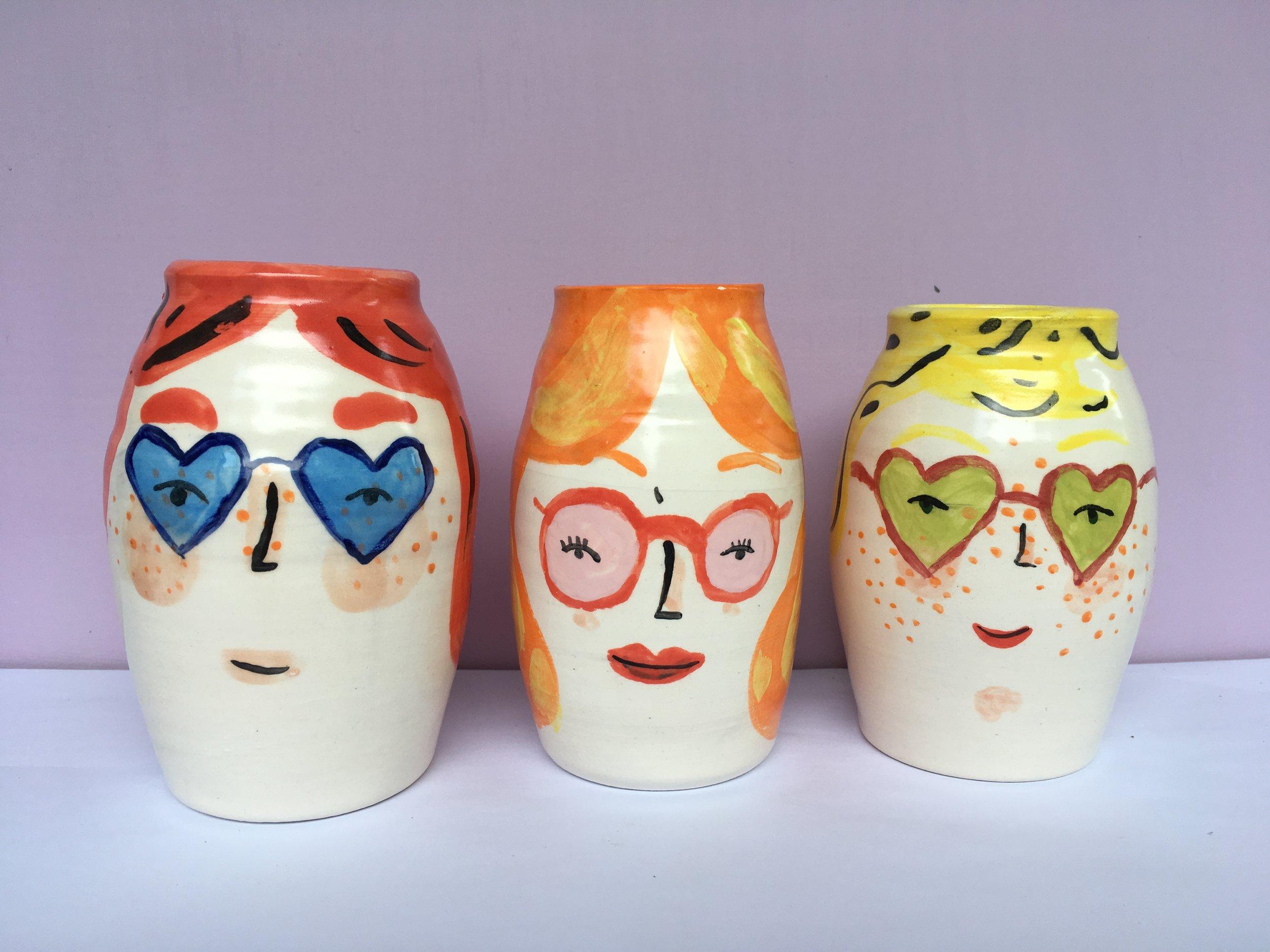 red orange yellow vases