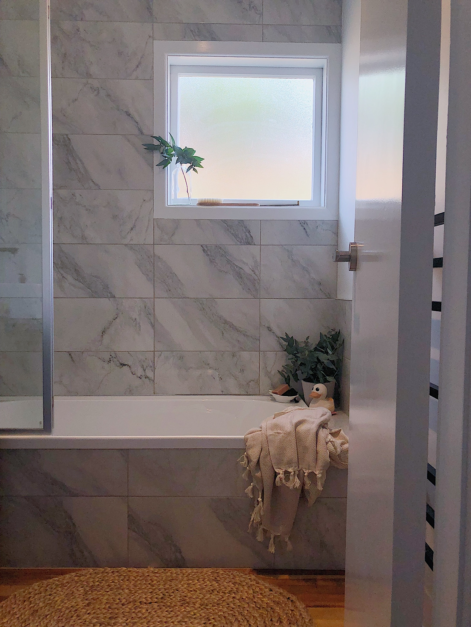Pearson and Projects Relocatable Reno Bathroom Project Marble Tile Bath Screen .jpg