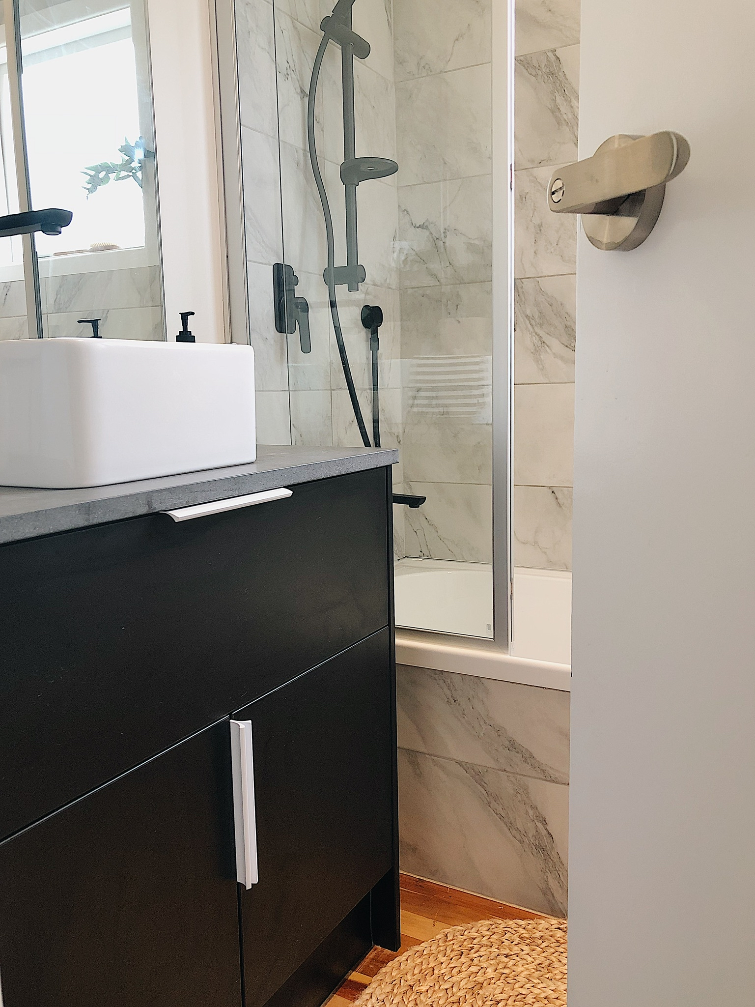 Pearson and Projects Relocatable Reno Bathroom Project Cutshop Vanity Black Stone Top Sqaure Basin Shower Over Bath.jpg