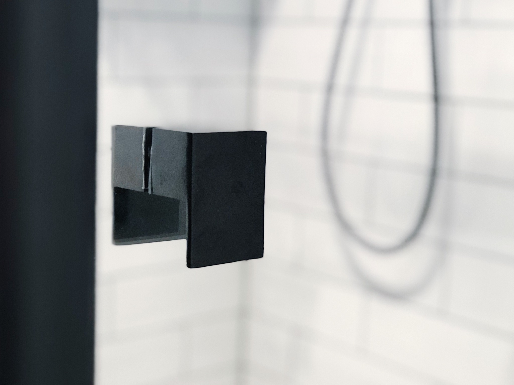 Pearson + Project The Reno Race The Rookies Bathroom Monochrome Subway Tiles Black Shower Frame.jpg