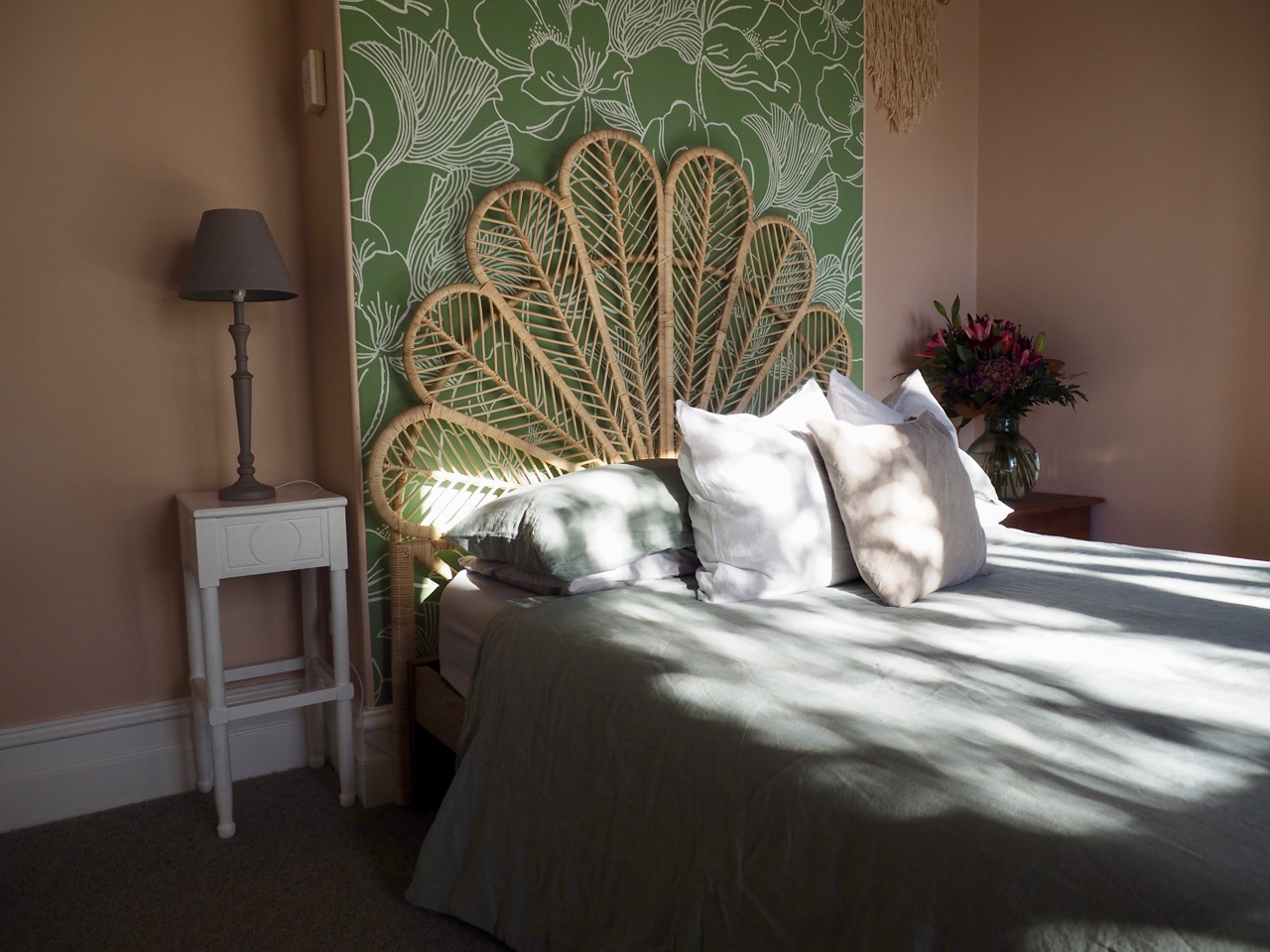 Charmer in Alexandra Master Bedroom Wallpaper Pink Green Pearl Drapes Rattan Pendant Sage Green Linen Lounger - 10.jpg