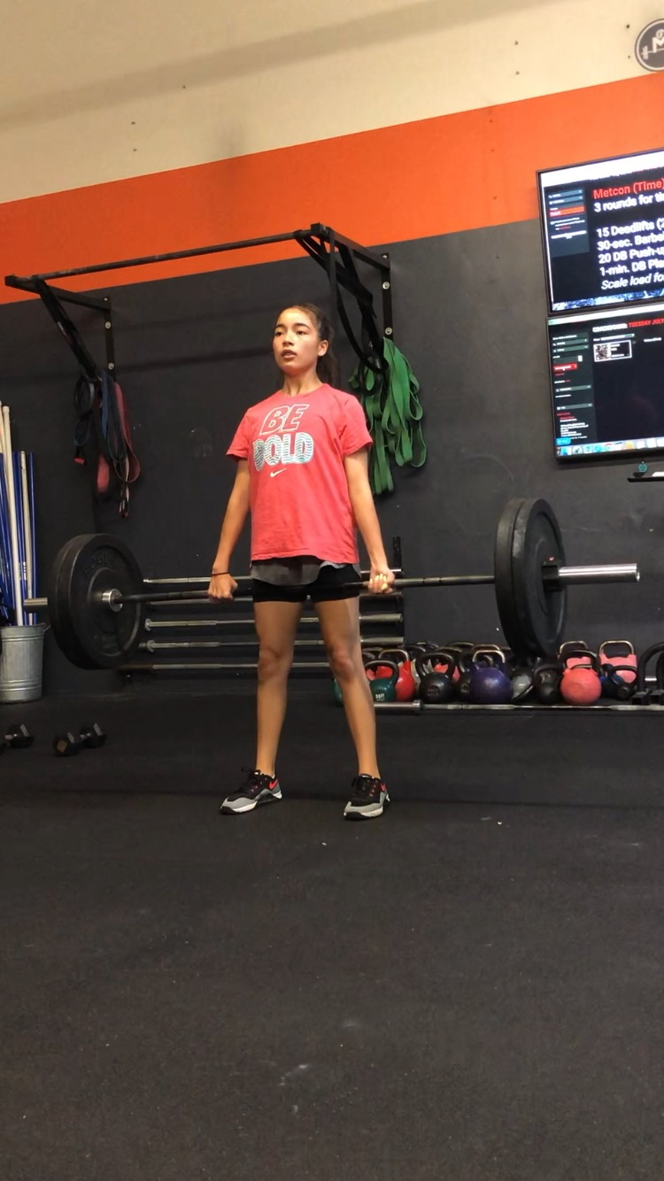 I first heard about CrossFit when my mom started doing it around 2014. A while after she started at the CrossFit, the gym came up with a kids class. My mom told me about it and she forced me to join. At the time, I was 9 years-old. My first WOD wasn't so bad but the day after I was very sore. Soon I was hooked and I thought it was super fun because I met other kids and I was also bored at home so I had something to do during the summer (other than chores...).  I like CrossFit because it gives me a variety of movements that I can do that most kids my age can't do. I go back to CFM because I love the people and how they motivate you. It helps you come back again and again to continue your progress. My experience with CrossFit has not only made me more fit but it has helped me gain more confidence with myself and has helped me do things I never thought I could do.