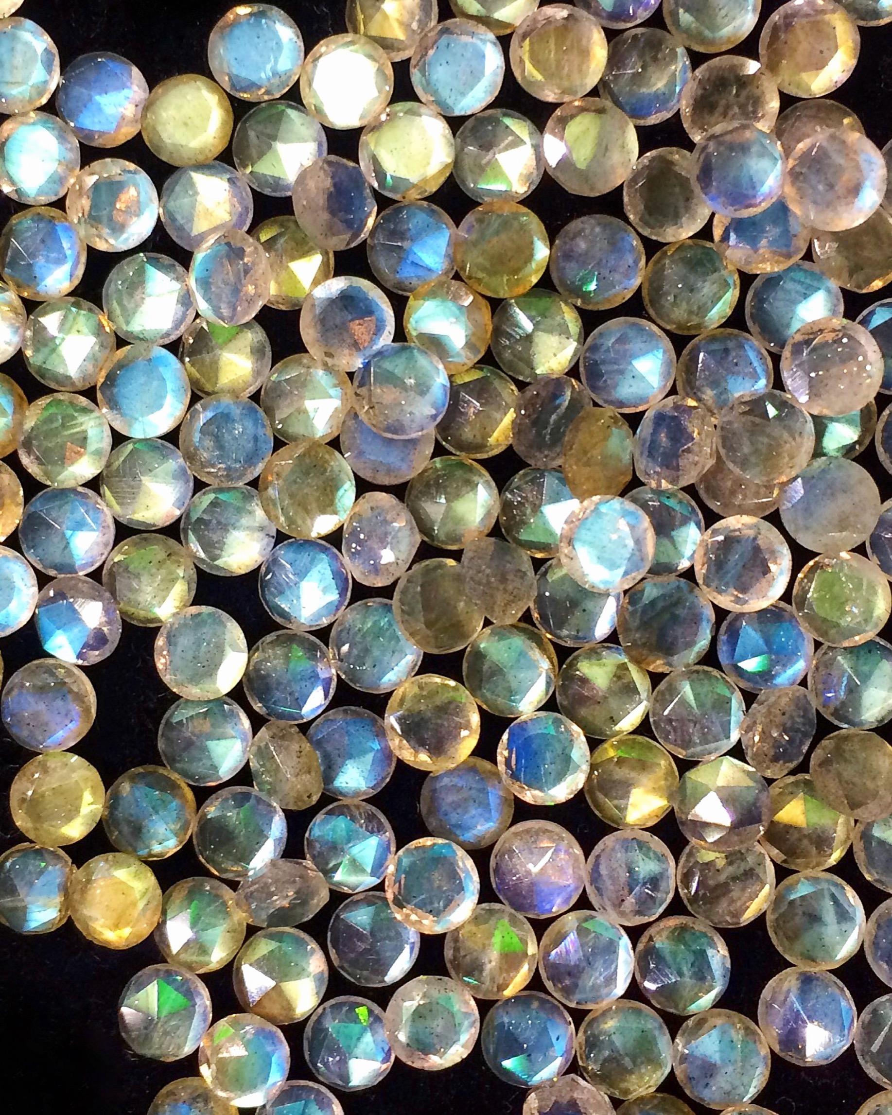 Incredibly lustrous labradorite rounds with really unique faceting.