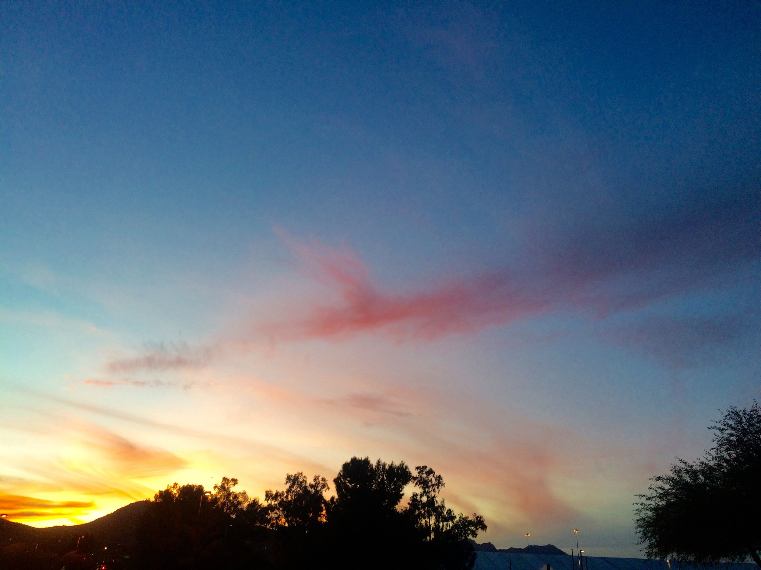 The sun sets over the GJX tent and Tucson mountains