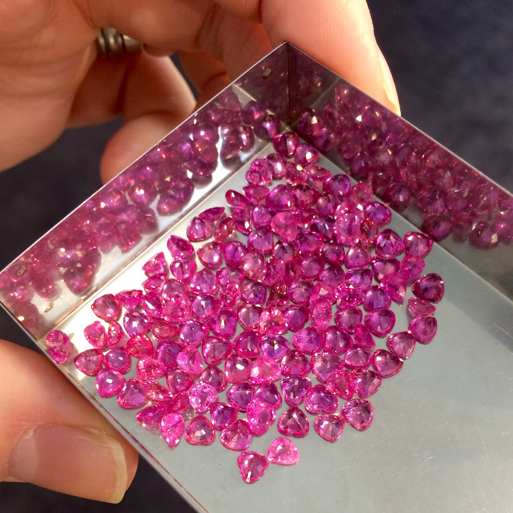 Crazy magenta pink sapphire in most darling heart shapes.