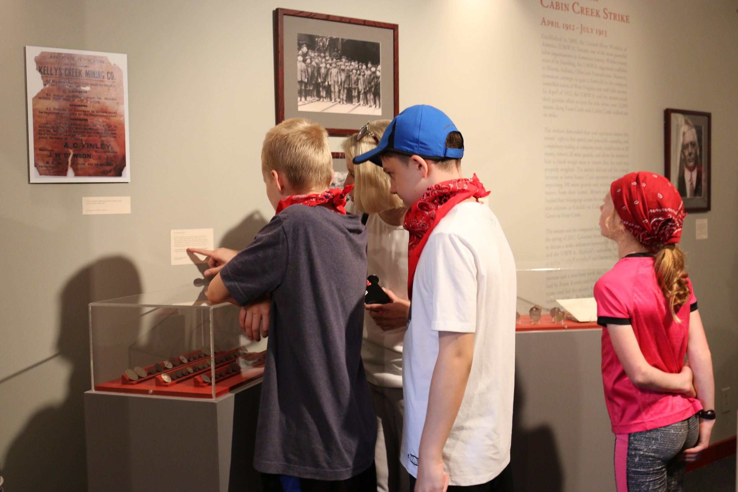 Students from Morgantown Learning Academy reading about Coal Camp Life and learning about scrip.