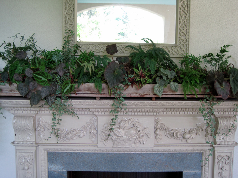 A grand display on the mantel of a porch fireplace!