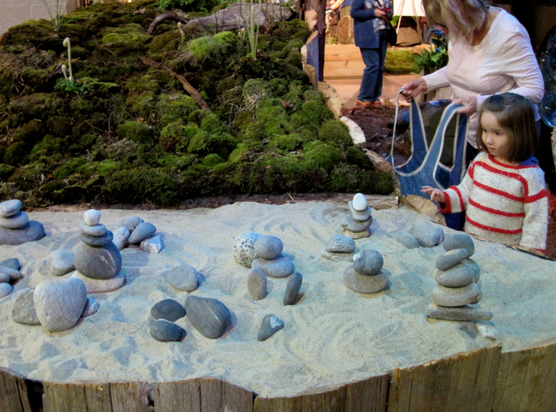 "An elevated ""sandbox"" bordered by a moss garden presents play possibilities for young and old."