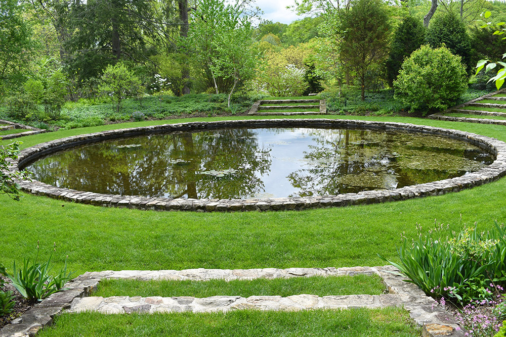 the Circular reflecting pool was used by the family as a swimming pool. it is 5' deep and lined with native stone.