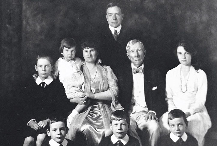 John D. Rockefeller with his family. John D. junior is standing in the back.