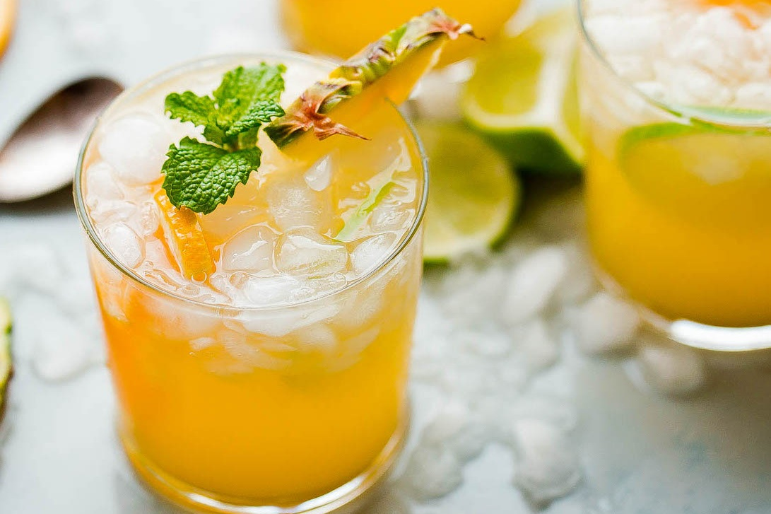 The Golden Burro - fresh lime, pineapple, mango, ginger, mint, club soda, garnished with pineapple & mint
