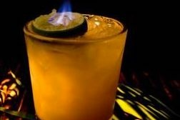 The Flaming Mule - fresh lime, pineapple, ginger, cinnamon, garnished with a flaming lime shell