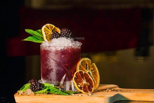 Blackberry Smash - fresh lemon, blackberry, orange, mint, garnished with blackberries & an orange slice