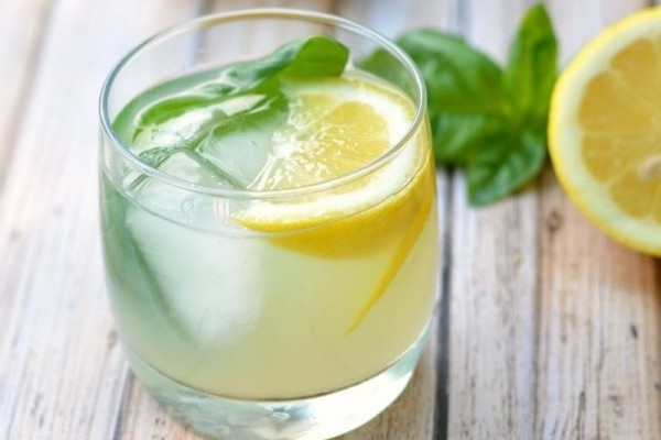 Basil Honey Sour - fresh lemon juice, basil, honey, garnished with a lemon slice & basil leaf