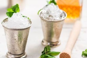 Mint Julep - homemade mint cane syrup with an essence of lime, garnished with a bouquet of mint
