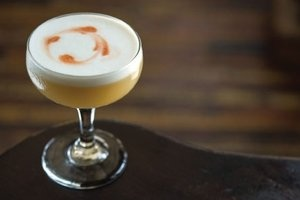 Classic Sour - fresh lemon juice blended with cane syrup, egg whites, bitters (ask about our custom stencils)