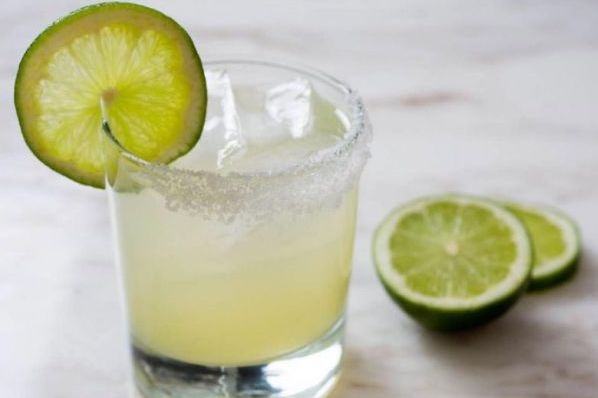 Classic Margarita - fresh lime juice, agave infused with orange peels, garnished with a lime & salt rim