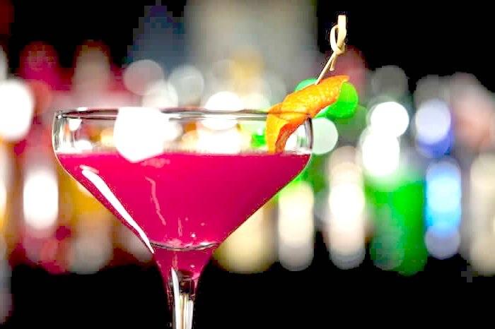 Cosmopolitan - fresh lime, cranberry, orange essence, cane syrup, garnished with an orange peel & lime