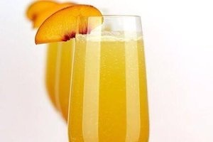 Peach Bellini - Fresh peaches blended with citrus, garnished with a peach slice