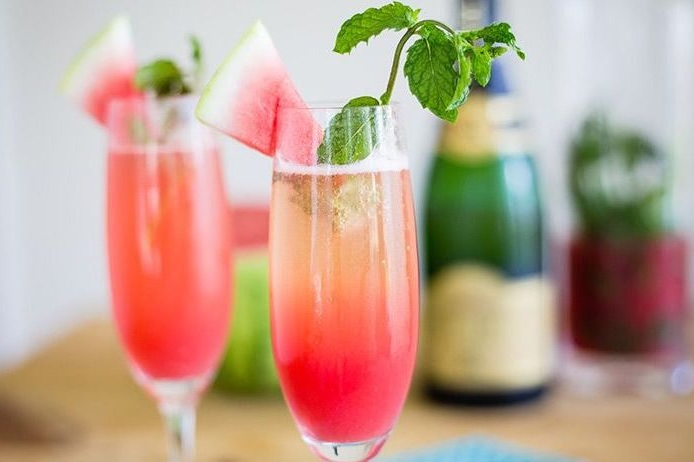 Watermelon Mimosa - Fresh watermelon, homemade mint syrup, fresh citrus, garnished with a watermelon slice & mint