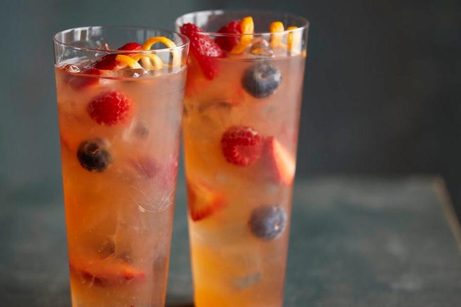 Berry Summer Shandy - fresh lemon, mixed berries, orange blossom water, garnished with fresh mixed berries & a lemon slice