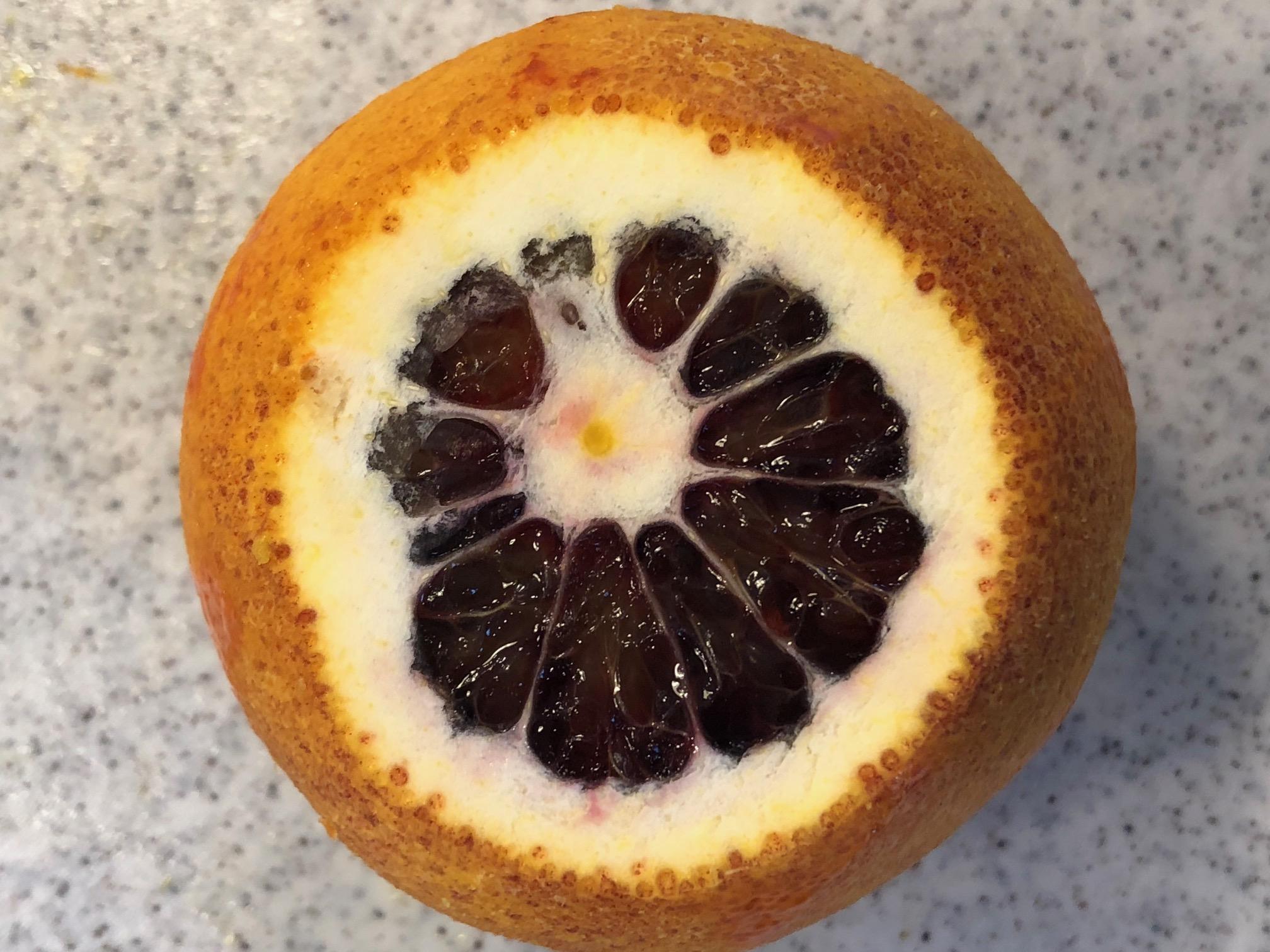 Slice off each end of the orange.