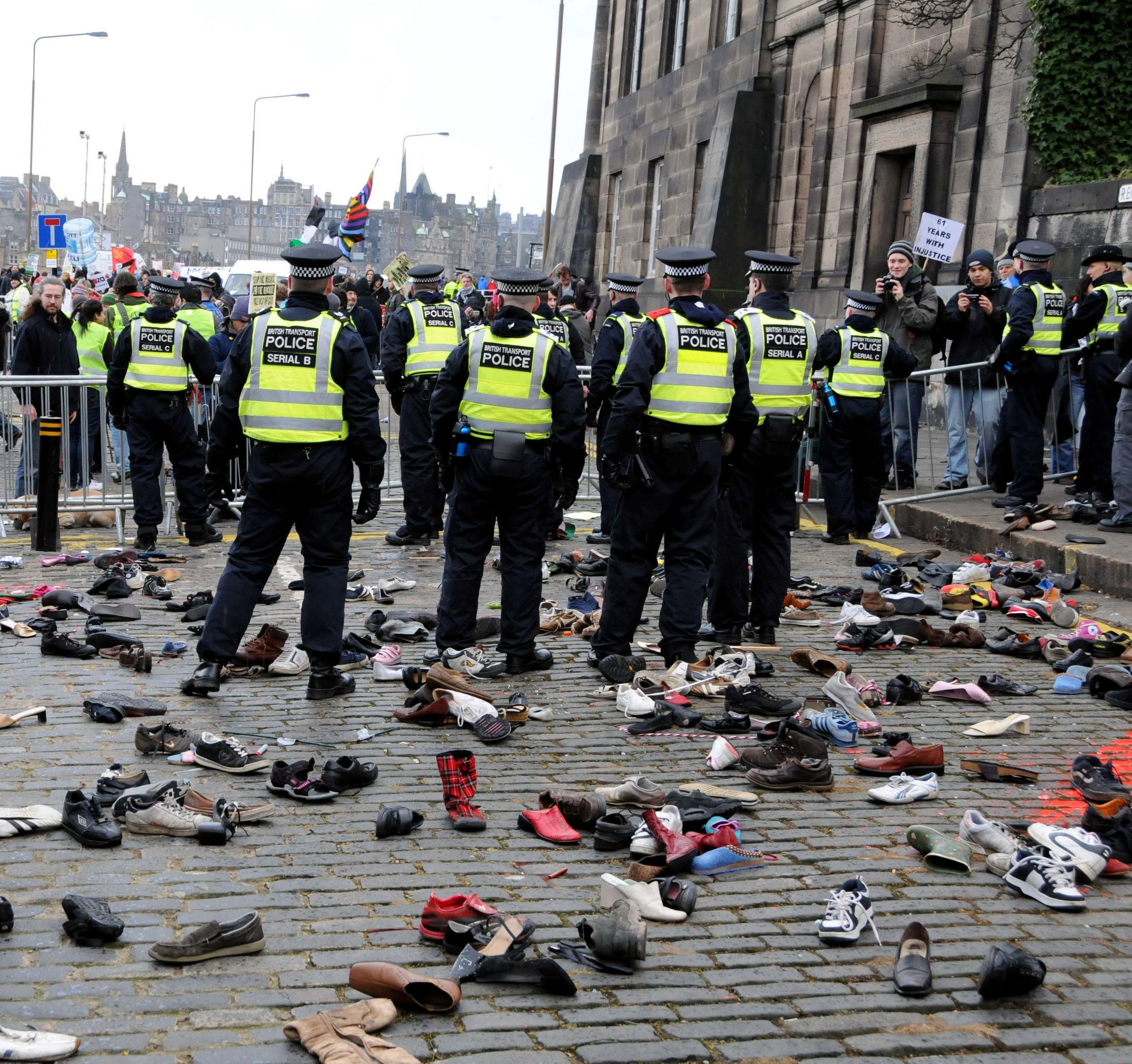 (20-20 Vision) Police line up after facing a barrage of thrown shoes.JPG