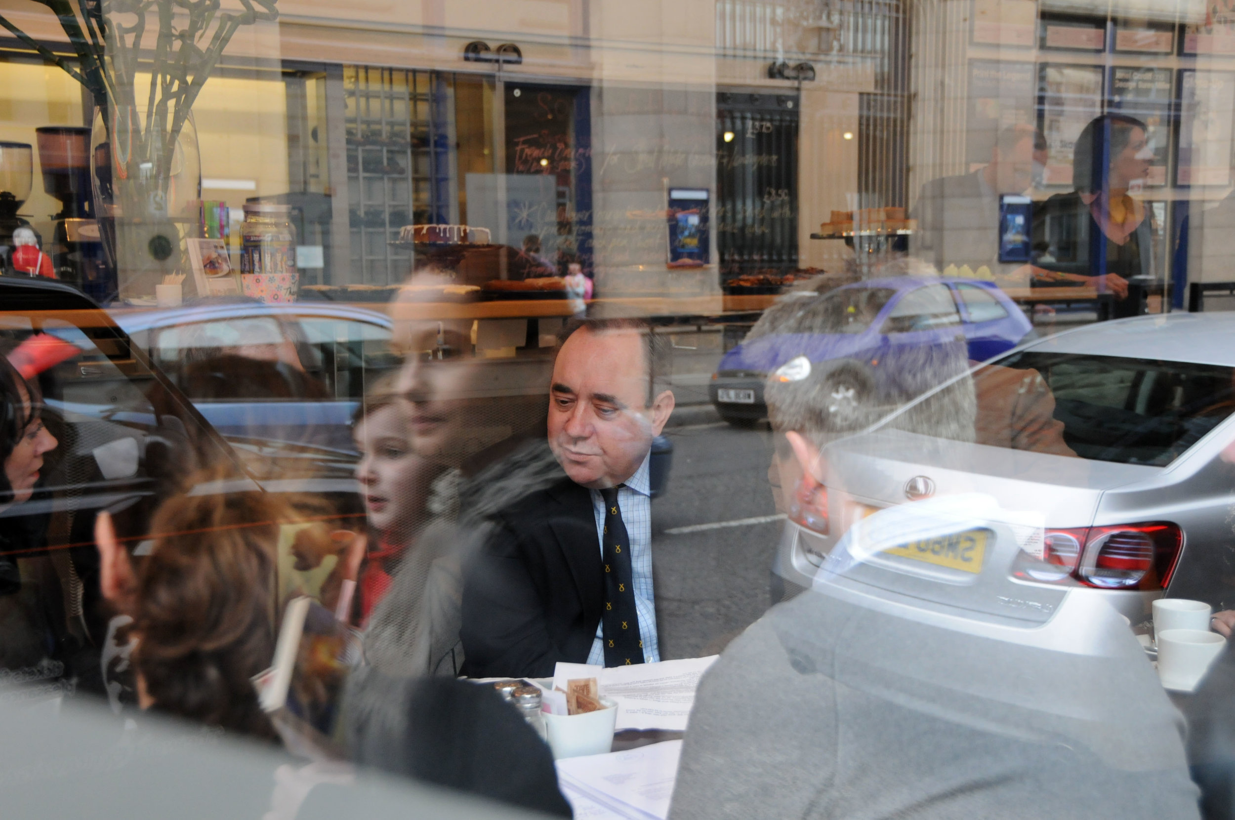 (20-20 Vision) Salmond Meets Campaigners as a young woman looks as she walks by.jpg