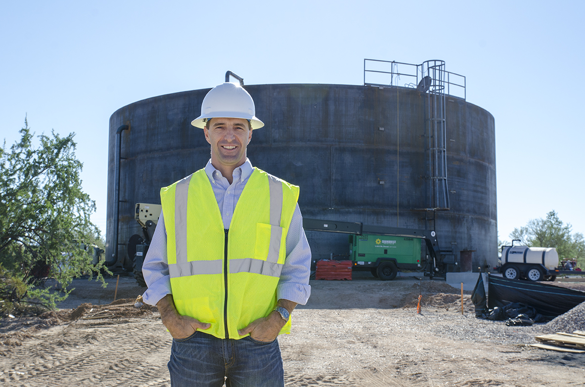 Assistant Water Director, Scott Schladweiler, on a construction site on Tangerine Rd.