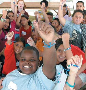 Participants showing off their water cycle bracelets from another Water Festival in Arizona